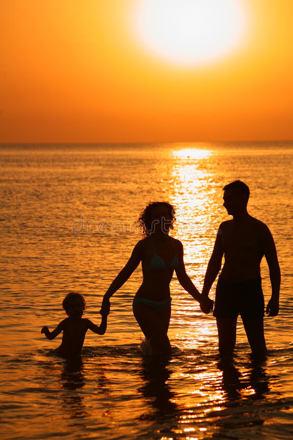 Free Parents With Child In Sea On Sunset Stock Photo - 6581700