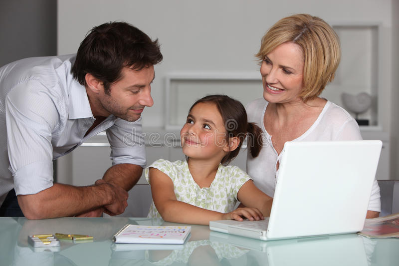Parents and young daughter stock photo