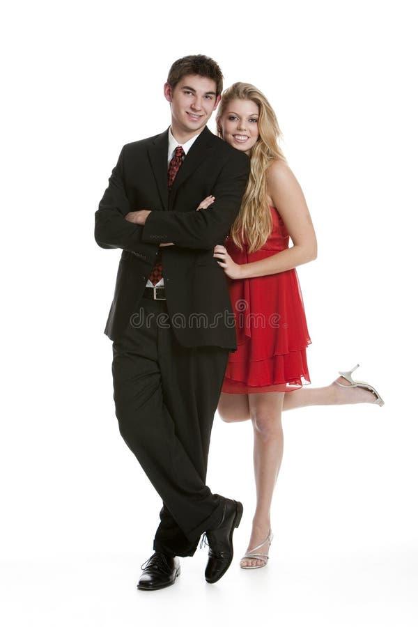Pares adolescentes vestidos en la ropa formal imagen de archivo libre de regalías