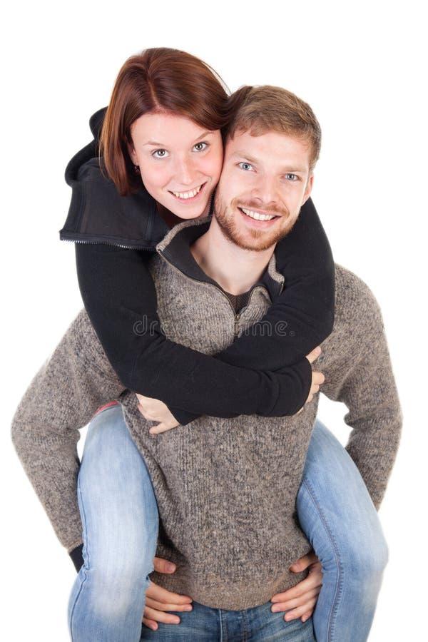 Pares adultos novos felizes foto de stock