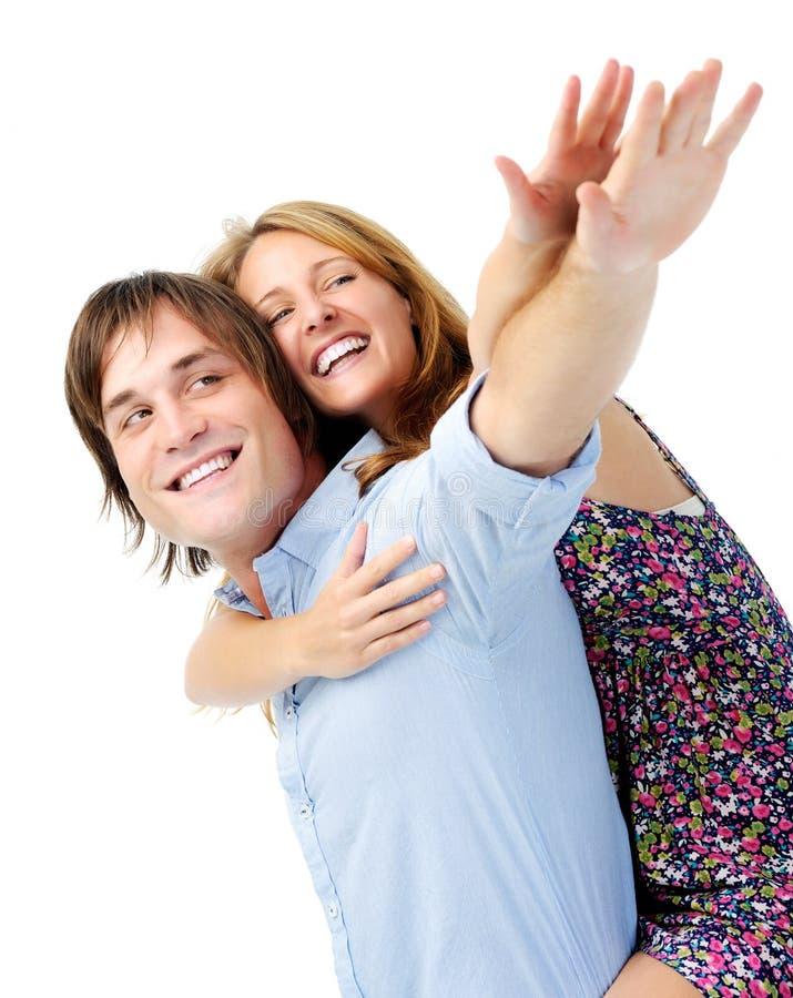 Pares alegres no amor afectuoso no estúdio imagem de stock royalty free