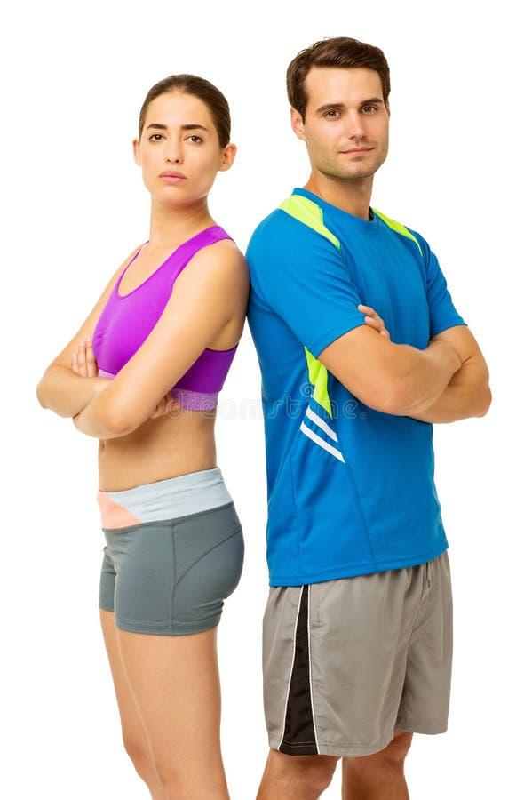 Pares aptos en la ropa de los deportes que se coloca de nuevo a la parte posterior imagenes de archivo