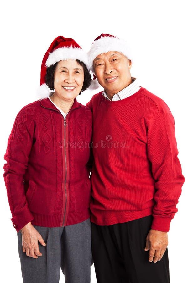 Pares asiáticos sênior que comemoram o Natal fotografia de stock royalty free