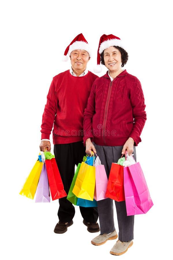Pares asiáticos sênior que comemoram o Natal fotos de stock royalty free