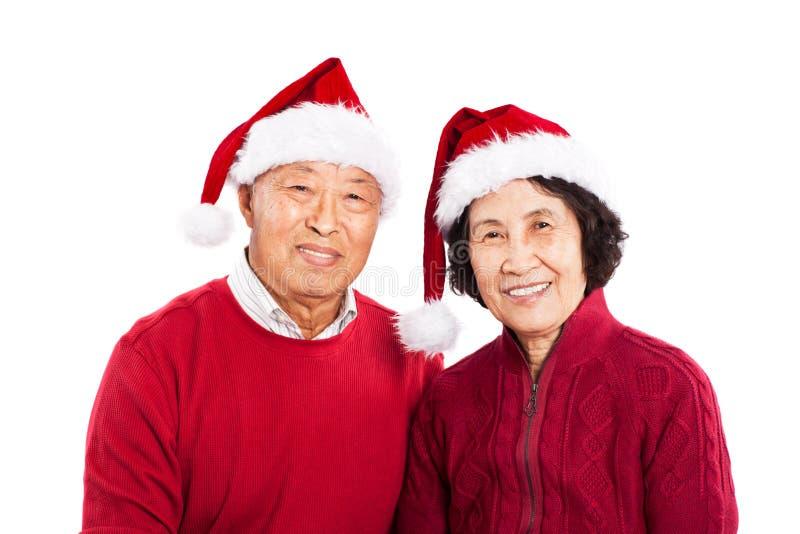 Pares asiáticos sênior que comemoram o Natal fotografia de stock
