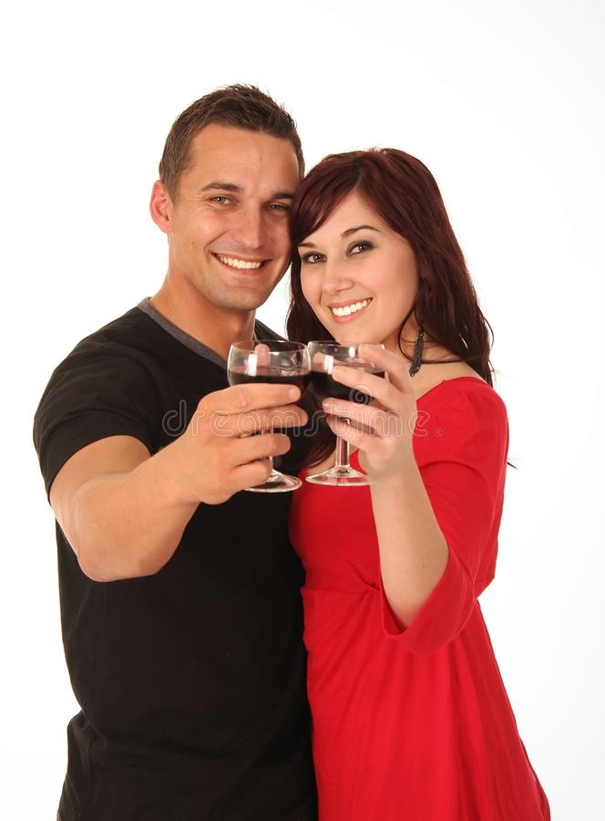 Pares atrativos beber de vinho fotos de stock royalty free