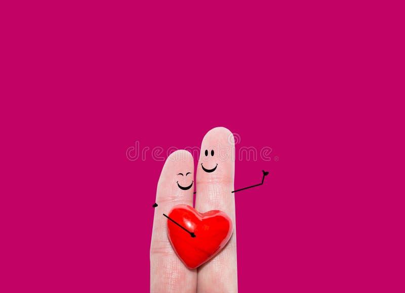 Pares bonitos do dedo que comemoram o dia do ` s do Valentim imagem de stock royalty free
