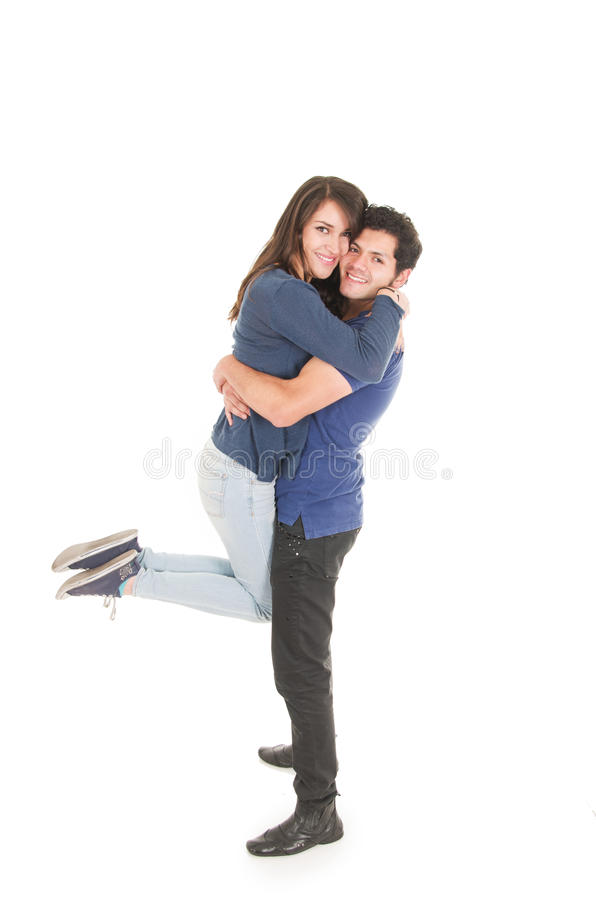 Pares bonitos que abraçam a menina levando do menino fotos de stock royalty free