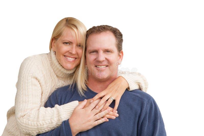 Pares caucasianos atrativos felizes no branco fotografia de stock royalty free