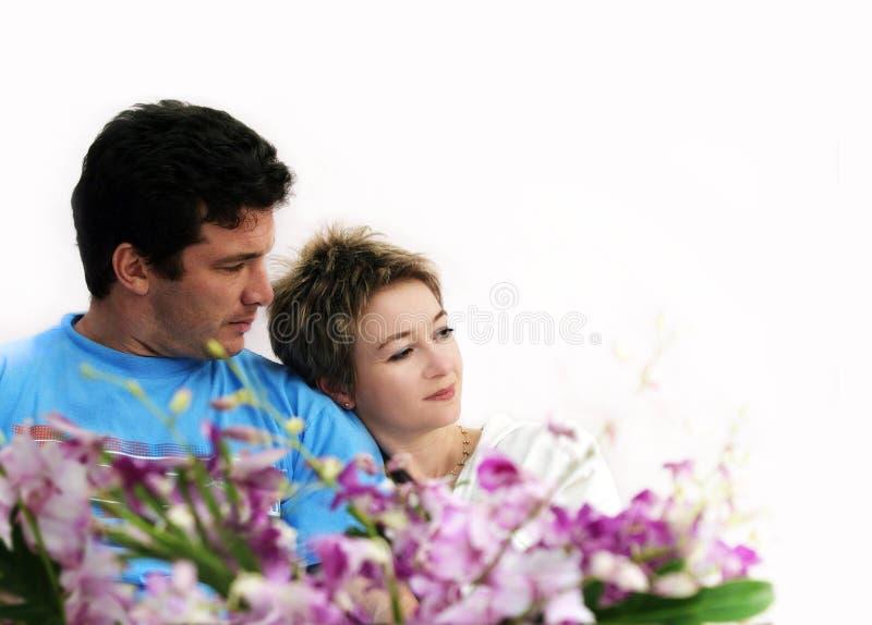 Pares con las flores imagenes de archivo
