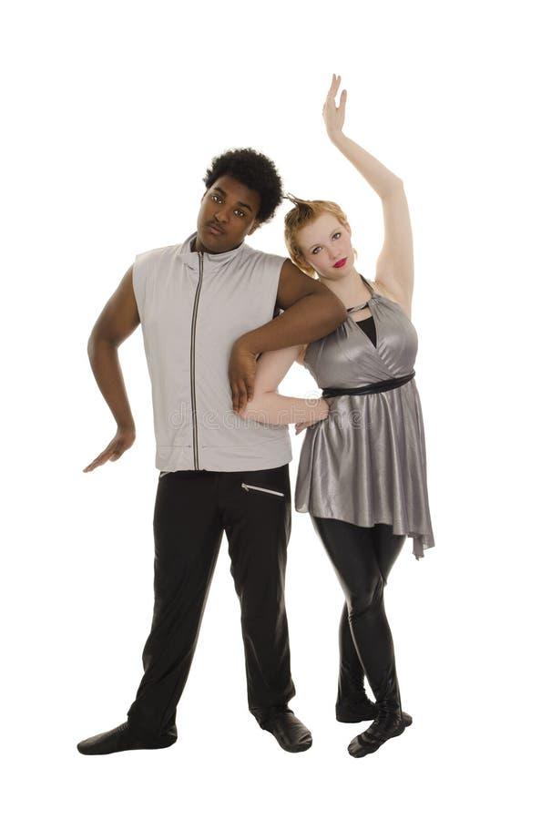 Pares contemporáneos de los bailarines de la edad de espacio imagenes de archivo