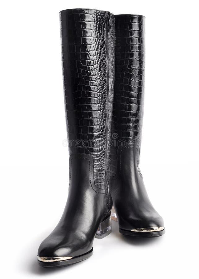 Pares das botas de couro das mulheres à moda fotografia de stock