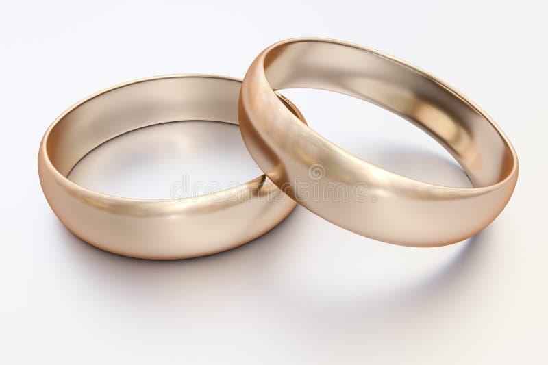 Pares de anéis de casamento do ouro imagens de stock royalty free