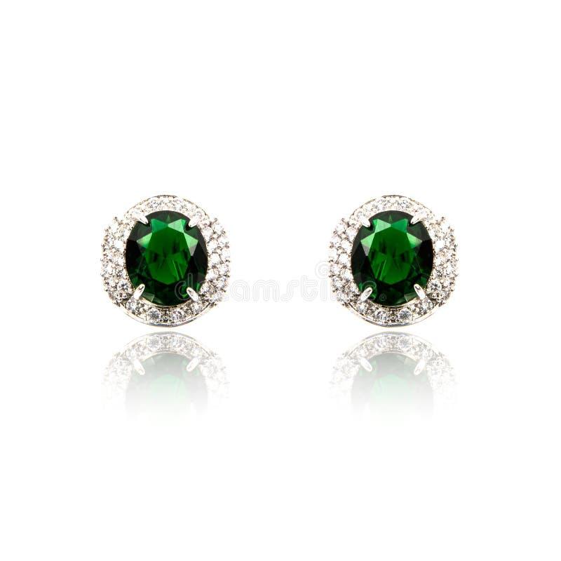 Pares de brincos esmeraldas isolados fotos de stock royalty free