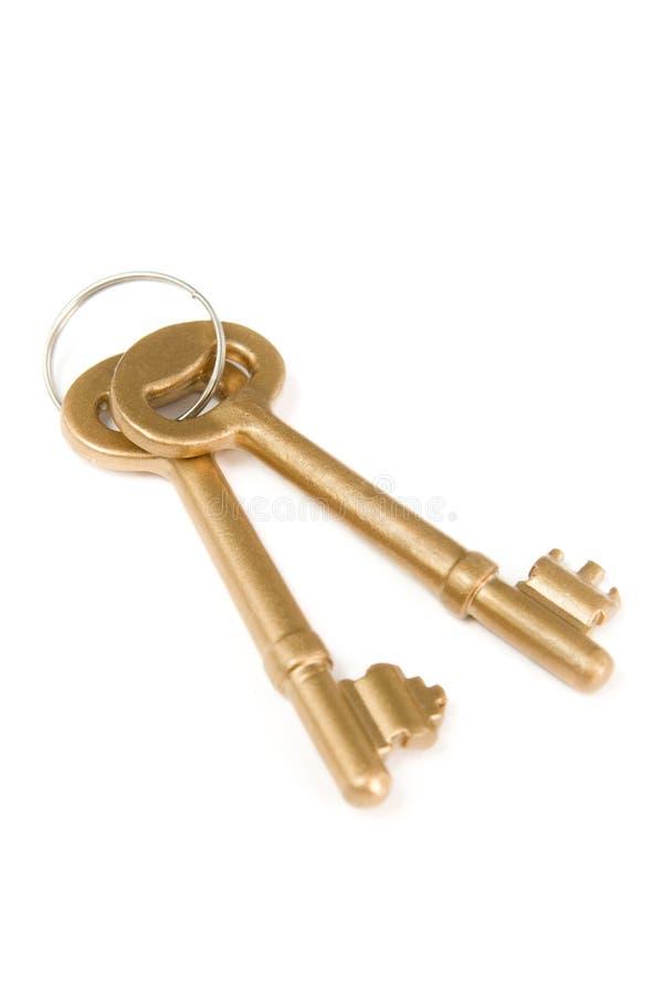 Pares de chaves douradas foto de stock