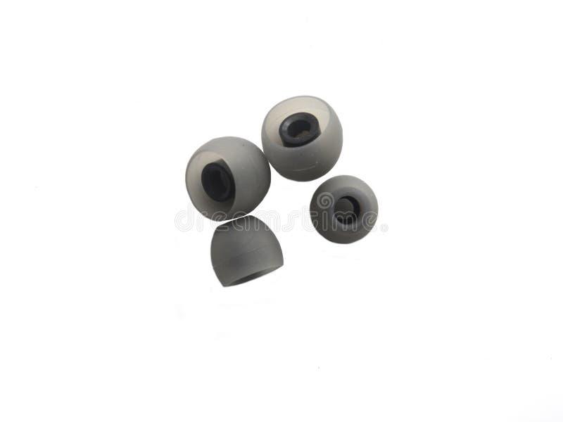 2 pares de cojines grises del auricular del color de diverso tamaño imagenes de archivo