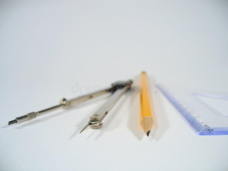 Pares de compassos, de lápis e de régua fotografia de stock royalty free