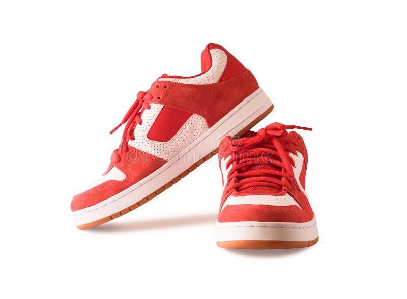 Pares de gumshoes o de zapatos rojos del patín imagenes de archivo