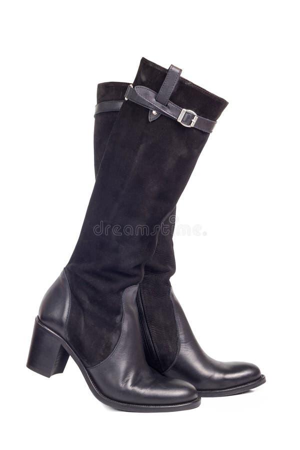 Pares de las botas de la mujer negra aisladas en el fondo blanco imagen de archivo libre de regalías