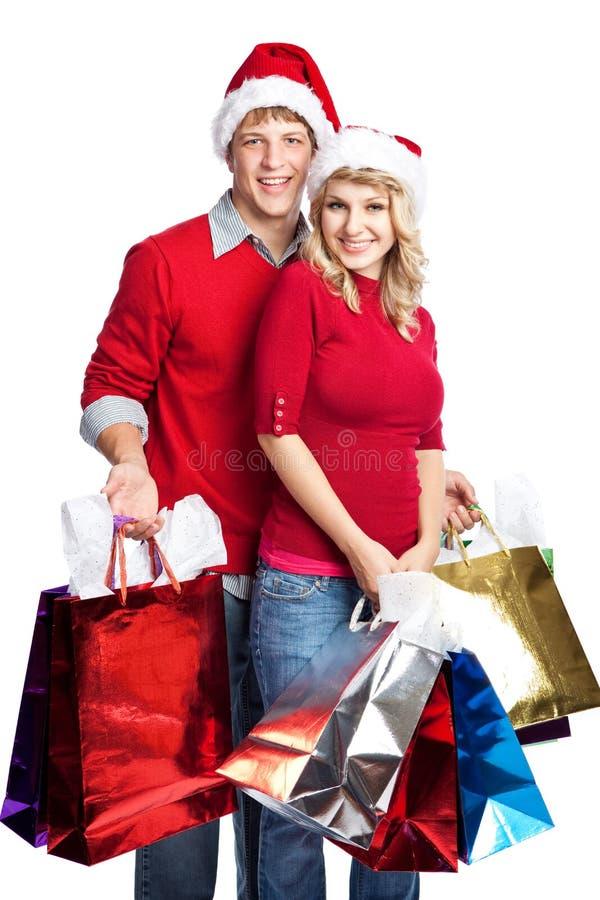 Pares de las compras de la Navidad fotografía de archivo libre de regalías