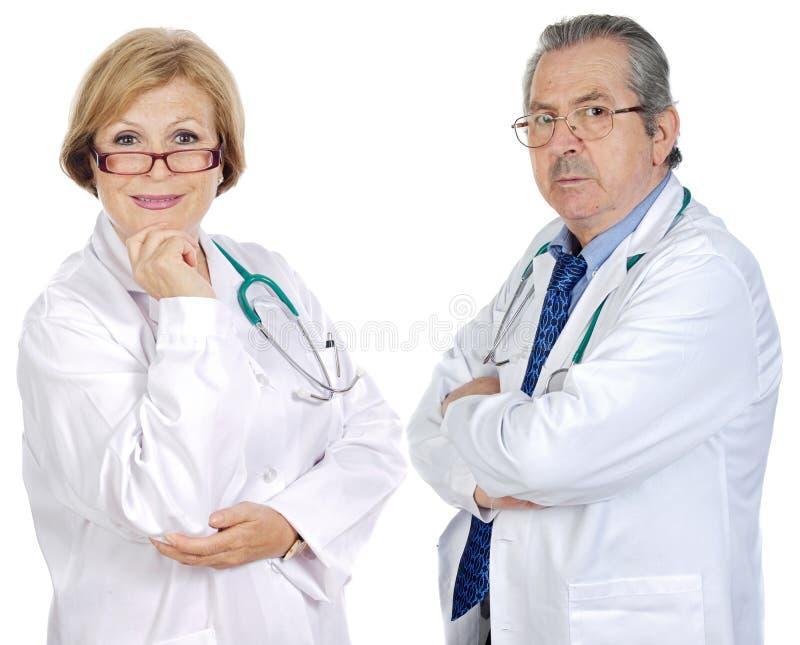 Pares de los doctores de los mayores foto de archivo