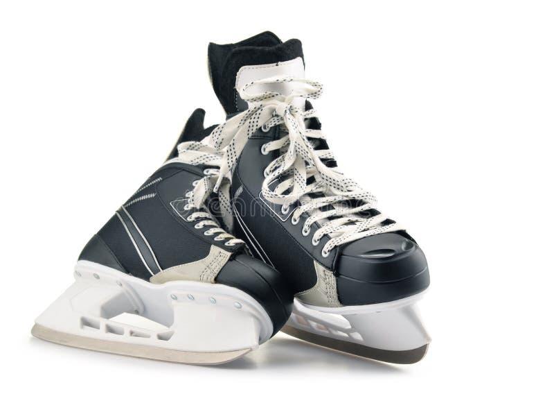 Pares de patines del hockey sobre hielo aislados en blanco imagen de archivo libre de regalías