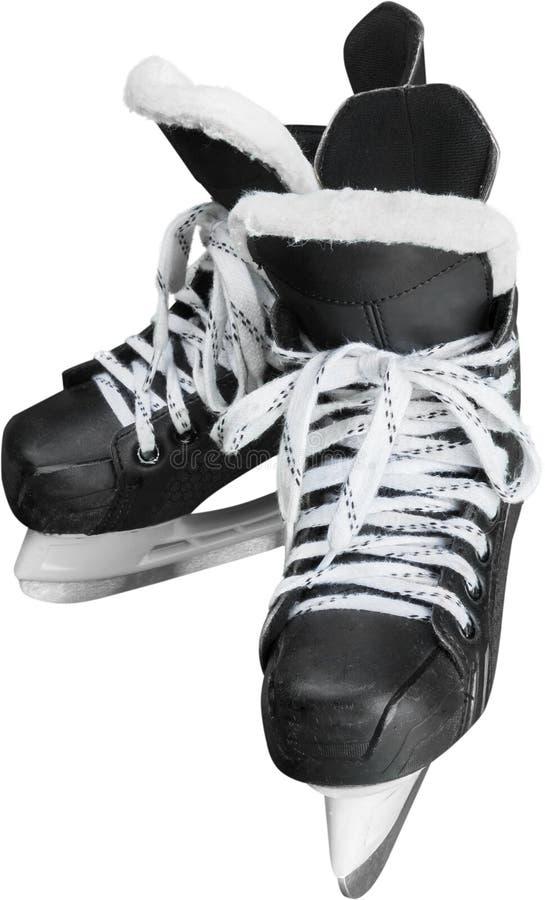 Pares de patines negros del hockey sobre hielo, aislados encendido imagen de archivo libre de regalías