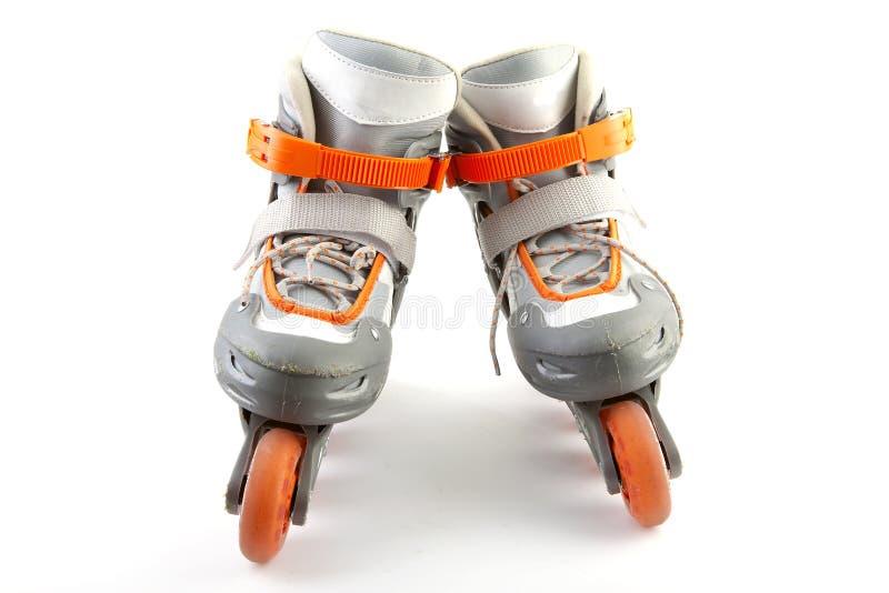 Pares de patins de rolo fotografia de stock royalty free