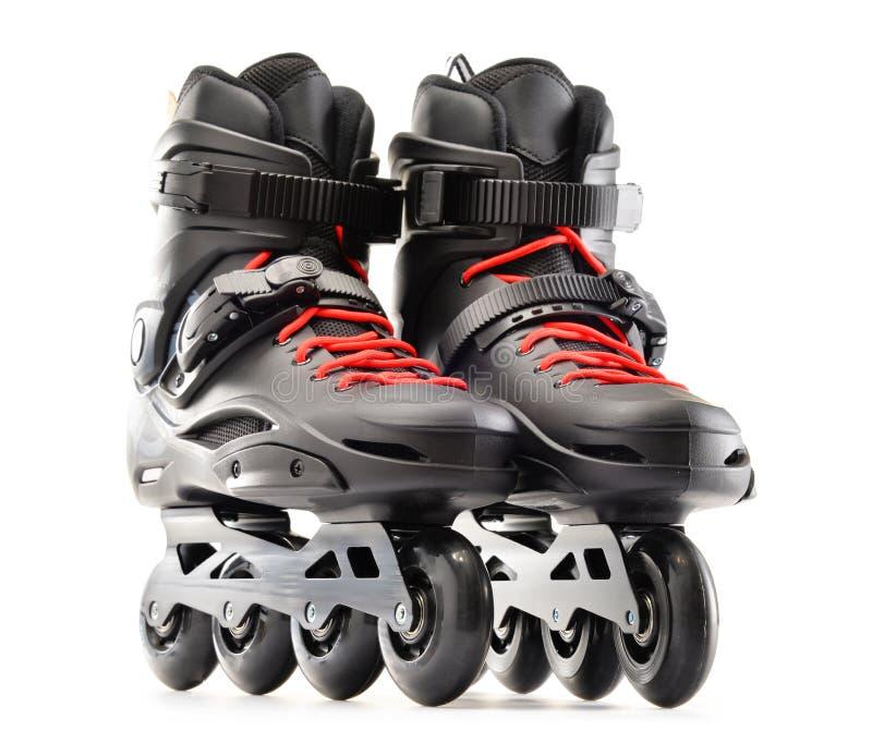 Pares de patins inline no fundo branco fotos de stock