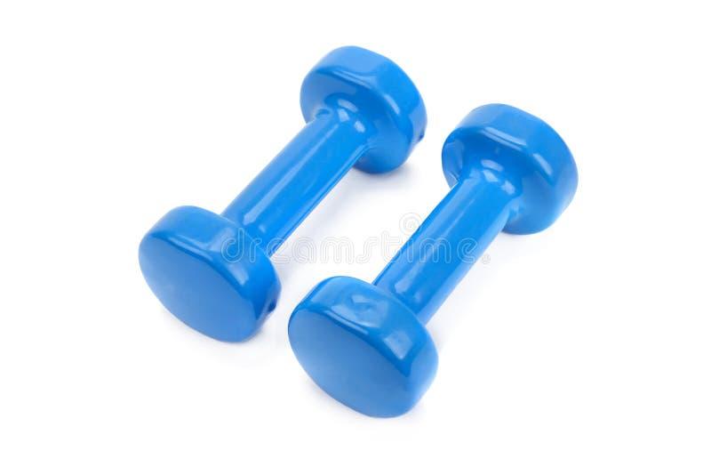 Pares de pesas de gimnasia azules aisladas en un fondo blanco fotografía de archivo libre de regalías