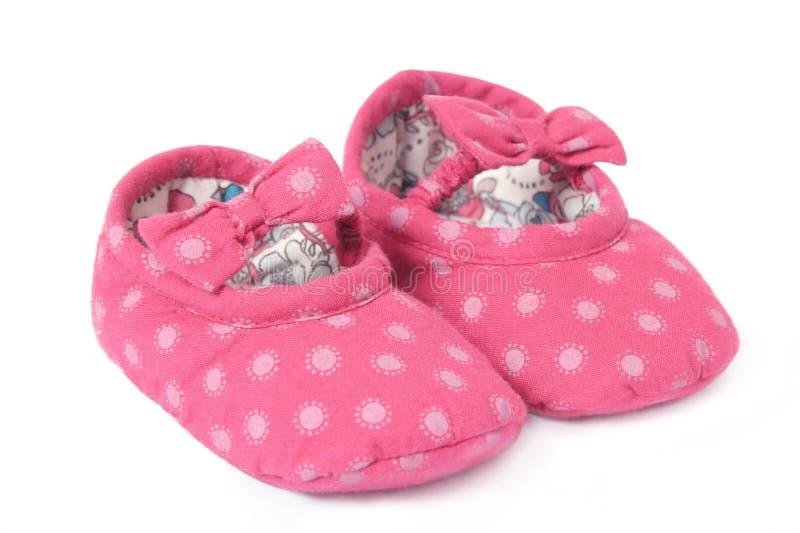 Pares de primeiras sapatas dos bebês fotos de stock royalty free
