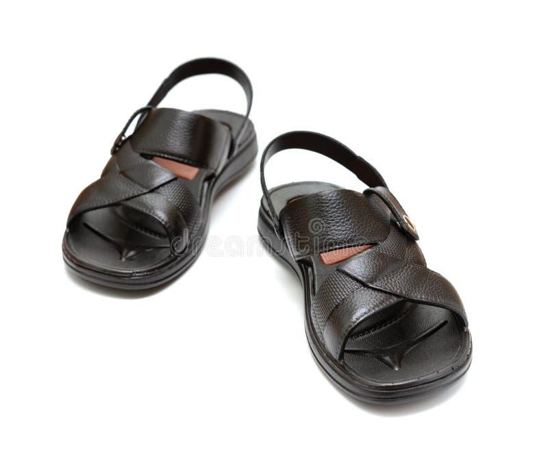 Pares de sandalia negra del ocio en blanco imagen de archivo libre de regalías