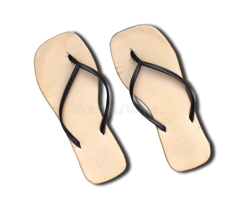 Pares de sandalias viejas del fracaso de tirón aisladas en blanco. fotografía de archivo libre de regalías