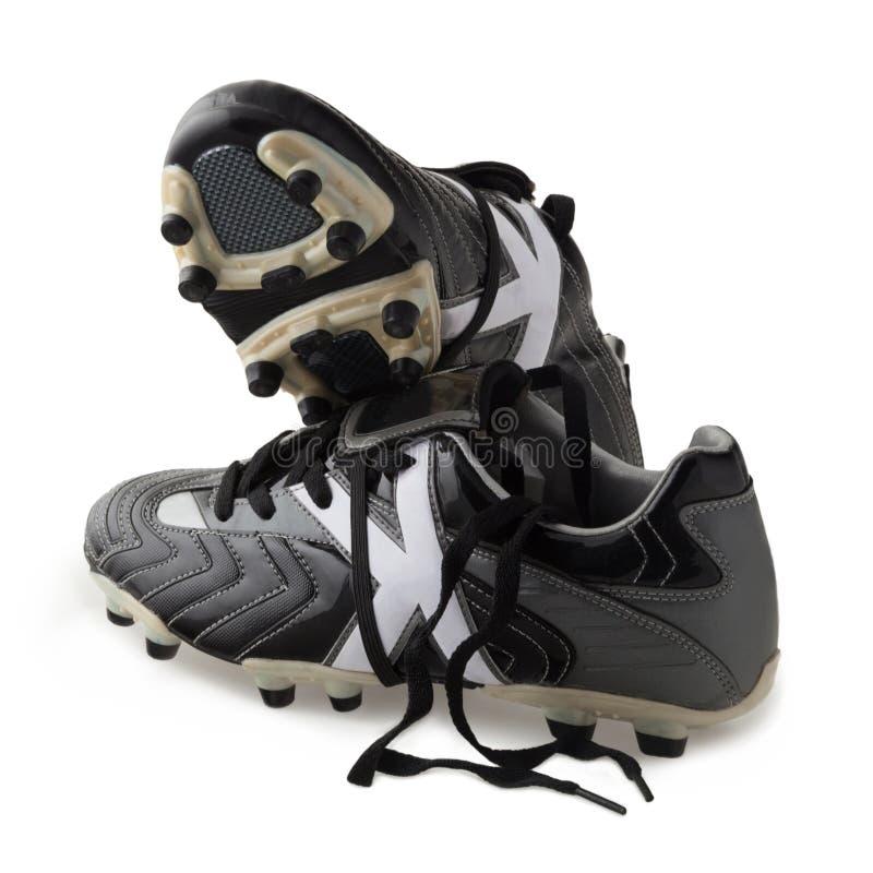Pares de sapatas do futebol no branco imagem de stock royalty free
