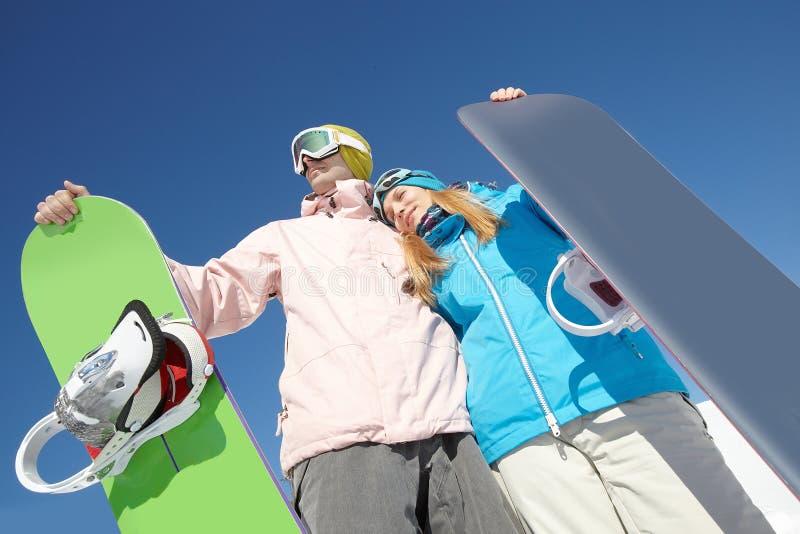 Pares de snowboarders imagen de archivo
