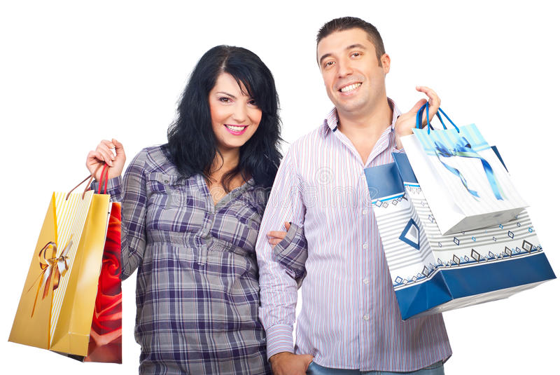 Pares de sorriso com sacos de compra fotografia de stock royalty free