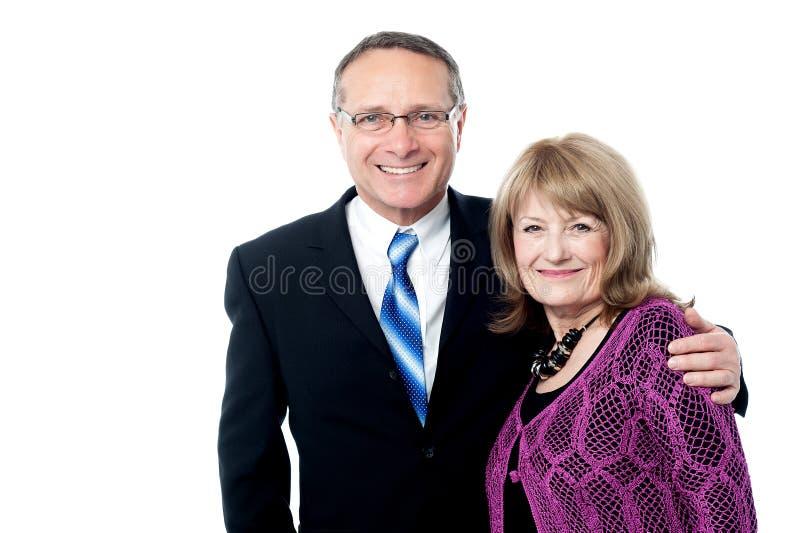 Pares de sorriso do negócio maduro fotos de stock