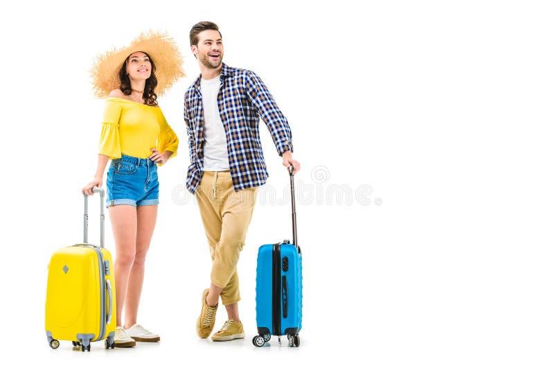 Pares de turistas que guardam bagagens fotografia de stock