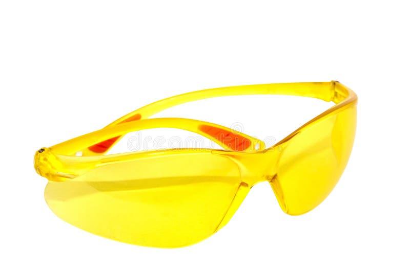 Pares de vidrios protectores plásticos amarillos brillantes foto de archivo