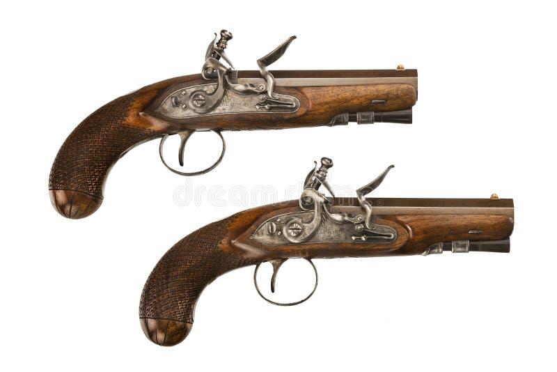 Pares del fusil de chispa del viejos vintage y original de las pistolas fotografía de archivo