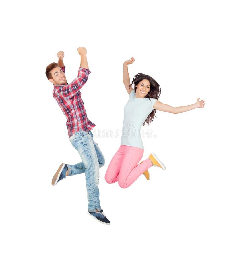 Pares del salto joven de los amantes imagen de archivo libre de regalías