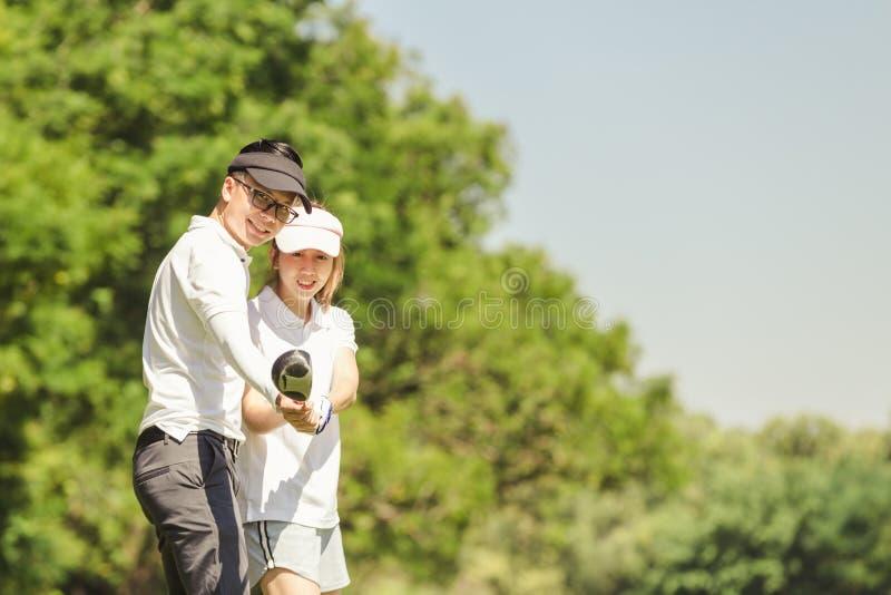 Pares do golfe fotografia de stock royalty free