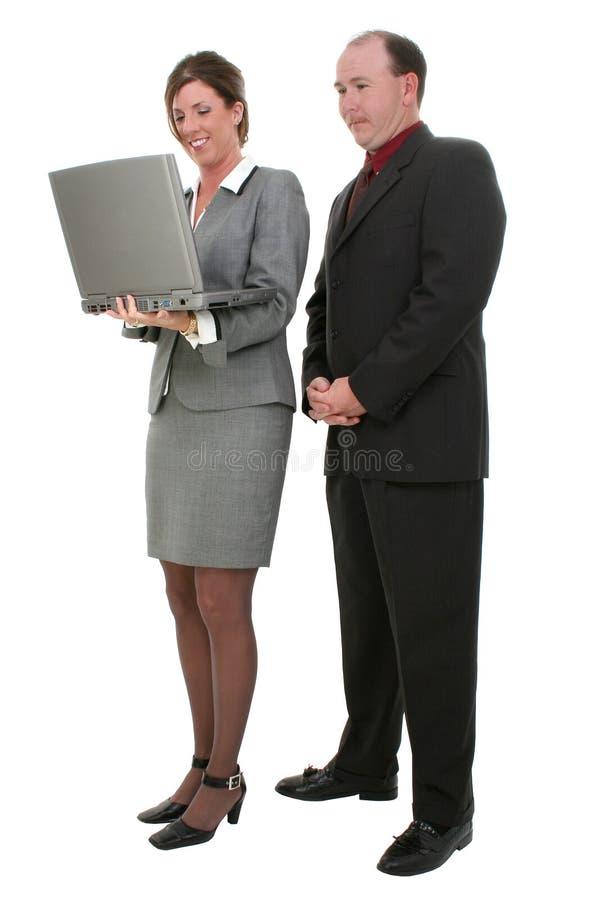 Pares do negócio com o computador portátil sobre o fundo branco foto de stock royalty free