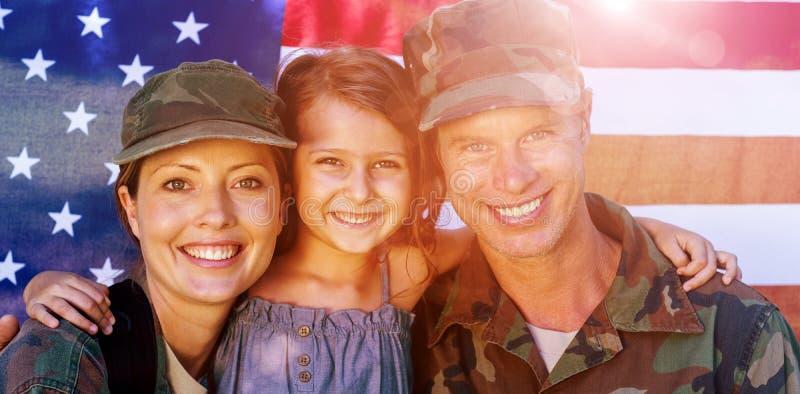 Pares do soldado reunidos com sua filha fotografia de stock