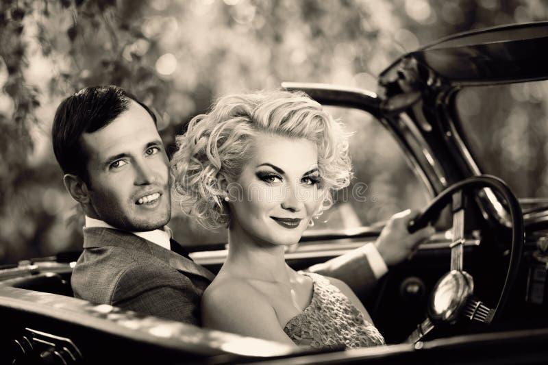 Pares e convertible retro foto de stock royalty free