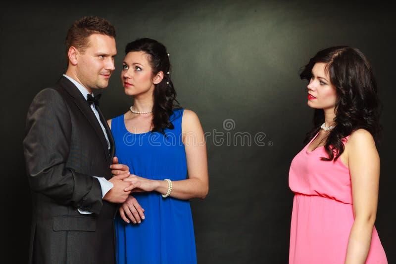 Pares e seu amante ciumento da mulher fotos de stock royalty free