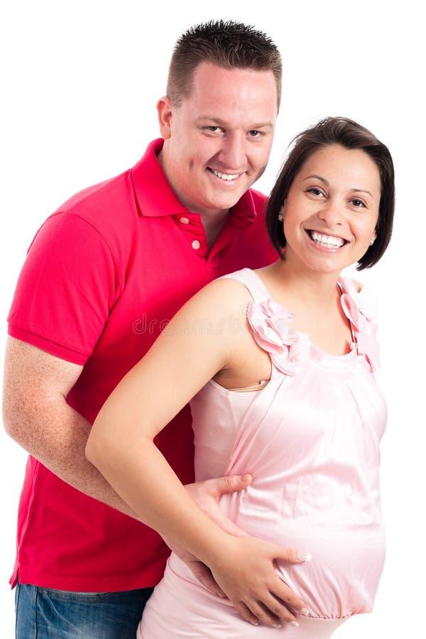 Pares embarazados felices