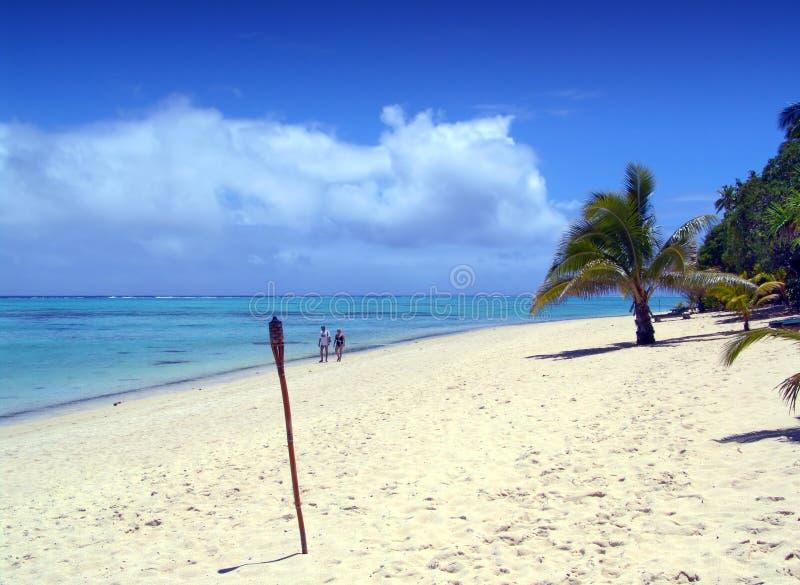 Pares en la playa fotografía de archivo