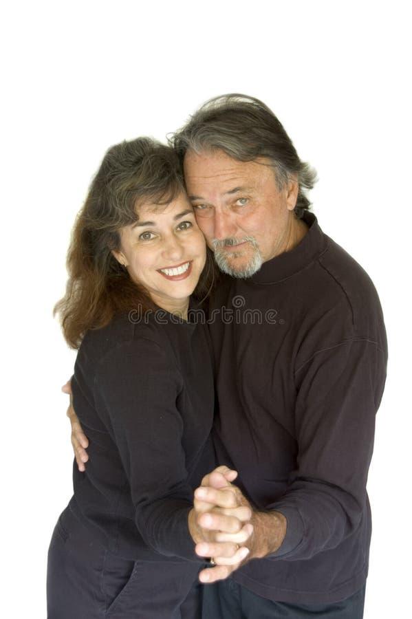 Pares envelhecidos médios felizes. fotografia de stock royalty free