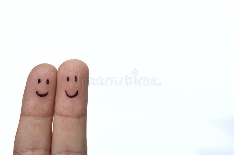 Pares felices del dedo fotos de archivo
